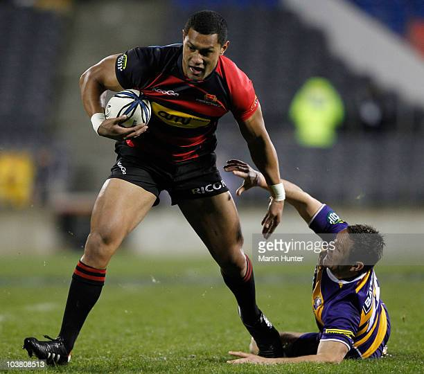 Robbie Fruean of Canterbury is tackled by Mike Delany of Bay of Plenty during the round six ITM Cup match between Canterbury and Bay of Plenty at AMI...
