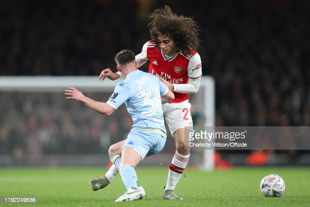 Robbie Gotts of Leeds is dwarfed by Matteo Guendouzi of Arsenal during the FA Cup Third Round match between Arsenal and Leeds United at Emirates...