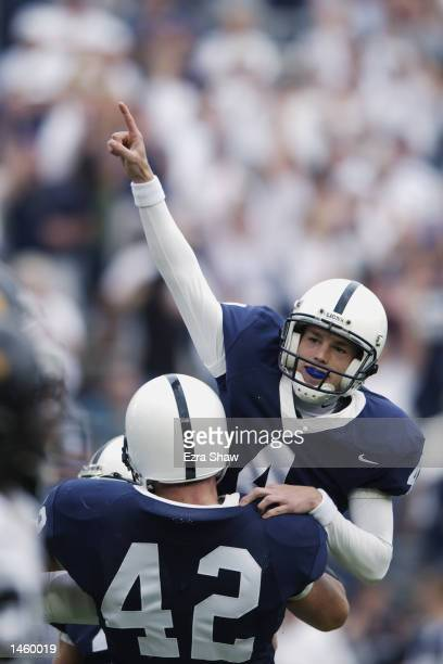 Robbie Gould of Penn State is lifted up by teammate Sean McHugh after Gould hit an extra point to send the game against Iowa into overtime on...