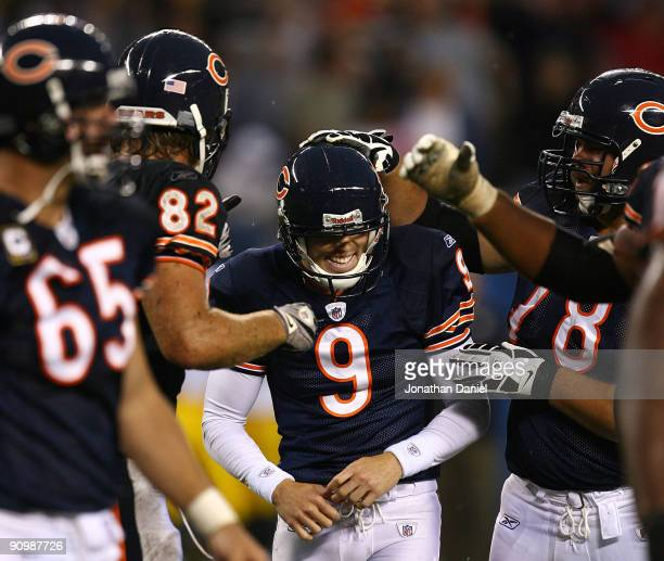 Robbie Gould of the Chicago Bears smiles as teammates including Greg Olsen and Kevin Shaffer congratulate him for kicking the gamewinning field goal...