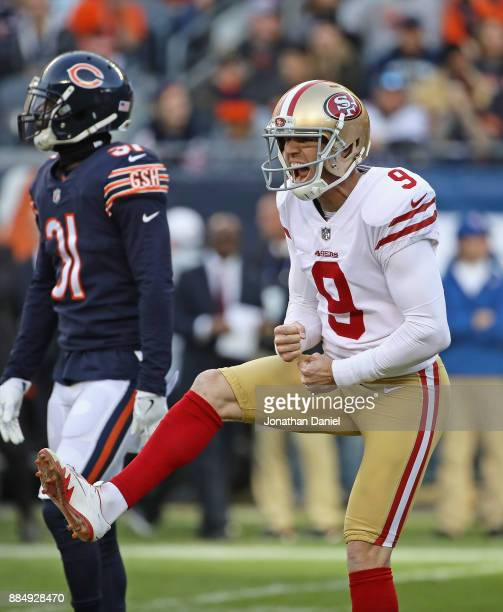 Robbie Gould of the San Francisco 49ers celebrates kicking the game winning field goal as Marcus Cooper of the Chicago Bears leaves the field at...