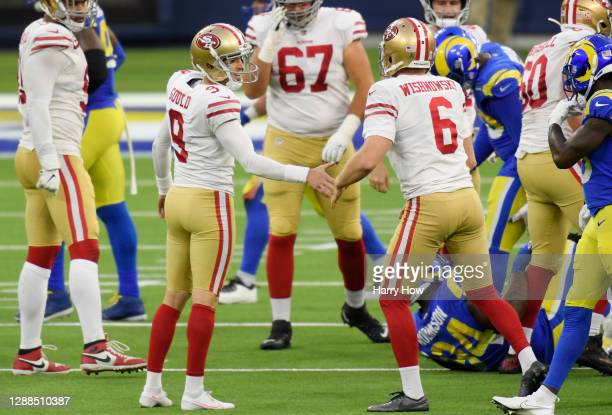 Robbie Gould of the San Francisco 49ers celebrates with Mitch Wishnowsky after making a game-tying field goal during the fourth quarter against the...