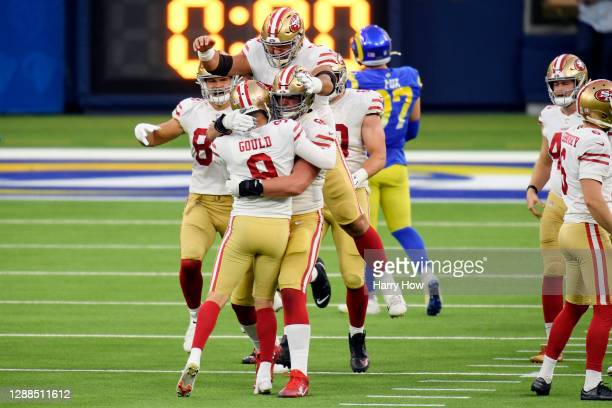 Robbie Gould of the San Francisco 49ers celebrates with teammates after making a game-winning field goal during the fourth quarter to defeat the Los...