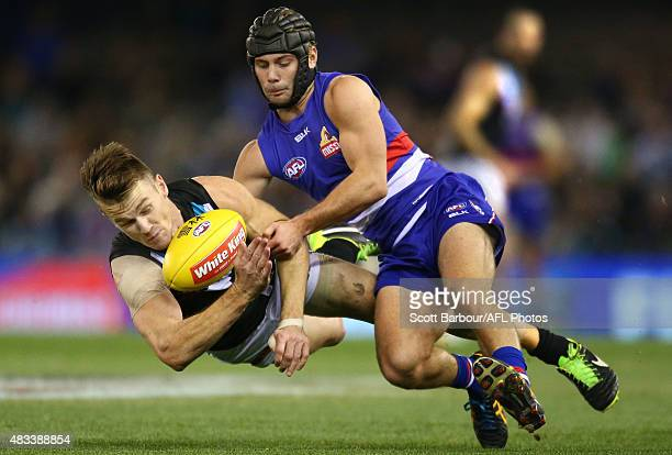 Robbie Gray of Port Adelaide and Caleb Daniel of the Western Bulldogs compete for the ball during the round 19 AFL match between the Western Bulldogs...