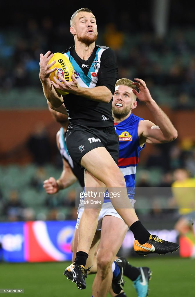 Robbie Gray of Port Adelaide marks in front of Jackson Trengove of the Bulldogs during the round 13 AFL match between Port Adelaide Power and the Western Bulldogs at Adelaide Oval on June 14, 2018 in Adelaide, Australia.