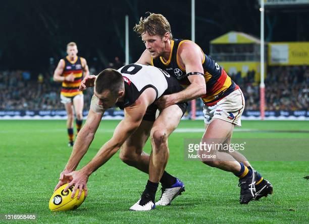 Robbie Gray of Port Adelaide tackled by Rory Sloane of the Crows during the round eight AFL match between the Port Adelaide Power and the Adelaide...