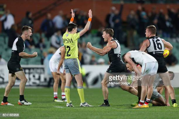 Robbie Gray of the Power and Brad Ebert celebrates the win after the final siren during the round 19 AFL match between the Port Adelaide Power and...