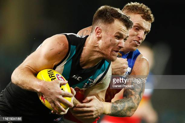 Robbie Gray of the Power and Mitch Robinson of the Lions contest the ball during the round 16 AFL match between the Port Adelaide Power and the...