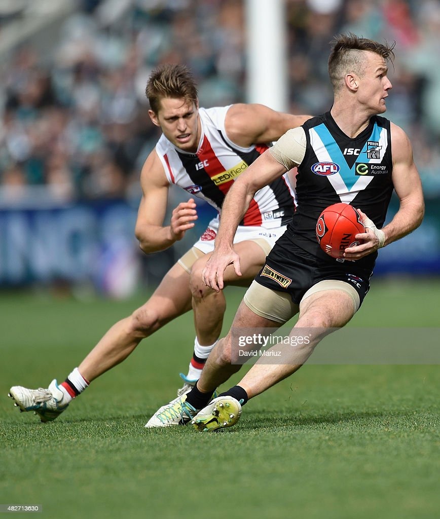 Robbie Gray of the Power and Sean Dempster of the Saints during the round 18 AFL match between the Port Adelaide Power and the St Kilda Saints at Adelaide Oval on August 2, 2015 in Adelaide, Australia.