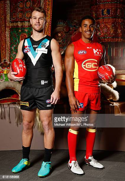 Robbie Gray of the Power and Touk Miller of the Suns pose for a photograph during an AFL announcement at The Chinese Museum Melbourne on October 26...