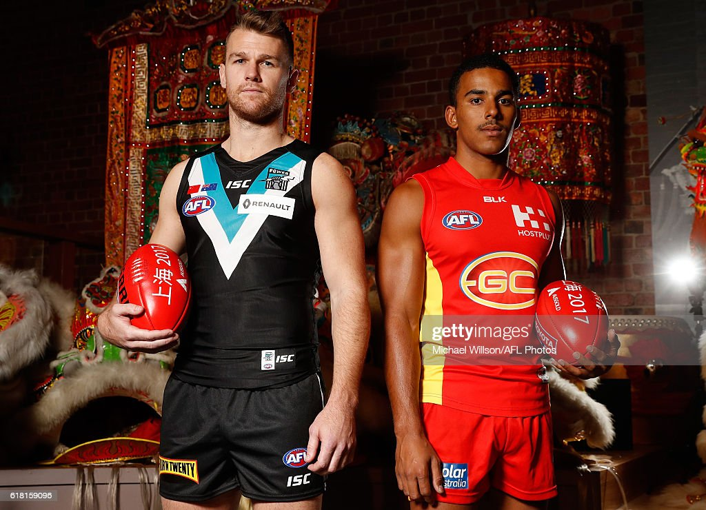 Robbie Gray of the Power (left) and Touk Miller of the Suns (right) pose for a photograph during an AFL announcement at The Chinese Museum Melbourne on October 26, 2016 in Melbourne, Australia.