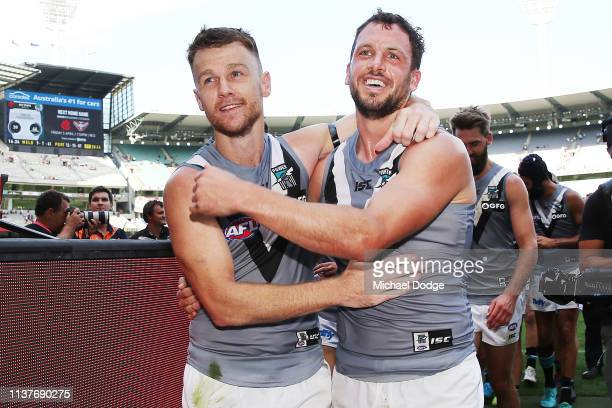 Robbie Gray of the Power celebrates the win with Travis Boak of the Power after winning his 200th match during the round one AFL match between the...