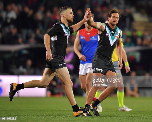 Robbie Gray of the Power celebrates with Steven Motlop of the Power during the round 14 AFL match between the Port Adelaide Power and the Melbourne...