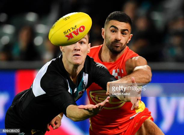 Robbie Gray of the Power competes for the mark with Adam Saad of the Suns during the round 23 AFL match between the Port Adelaide Power and the Gold...