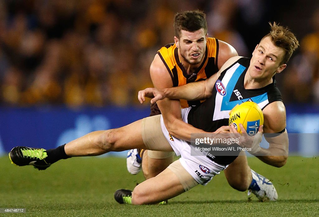 Robbie Gray of the Power is tackled by Ben Stratton of the Hawks during the 2015 AFL round 21 match between the Hawthorn Hawks and Port Adelaide Power at Etihad Stadium, Melbourne, Australia on August 21, 2015.