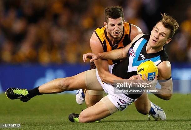 Robbie Gray of the Power is tackled by Ben Stratton of the Hawks during the 2015 AFL round 21 match between the Hawthorn Hawks and Port Adelaide...