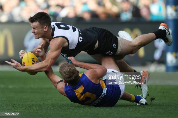 Robbie Gray of the Power is tackled by Brad Sheppard of the Eagles during the 2017 AFL round 07 match between Port Adelaide Power and the West Coast...