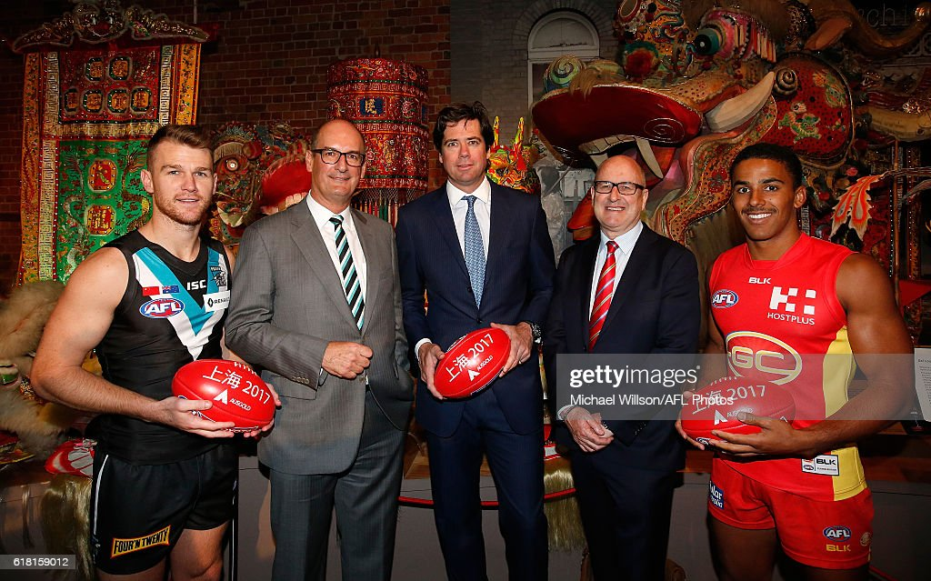 Robbie Gray of the Power, Power President David Koch, AFL CEO Gillon McLachlan, Suns Chairman Tony Cochrane and Touk Miller of the Suns pose for a photograph during an AFL announcement at The Chinese Museum Melbourne on October 26, 2016 in Melbourne, Australia.