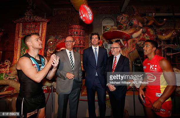 Robbie Gray of the Power, Power President David Koch, AFL CEO Gillon McLachlan, Suns Chairman Tony Cochrane and Touk Miller of the Suns pose for a...