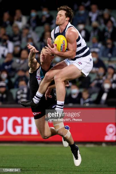 Robbie Gray of the Power tackles Gary Rohan of the Cats during the 2021 AFL Round 23 match between the Adelaide Crows and the North Melbourne...
