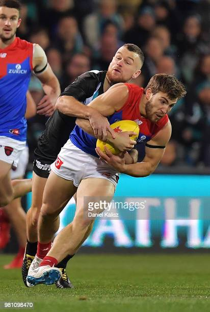 Robbie Gray of the Power tackles Jack Viney of the Demons during the round 14 AFL match between the Port Adelaide Power and the Melbourne Demons at...