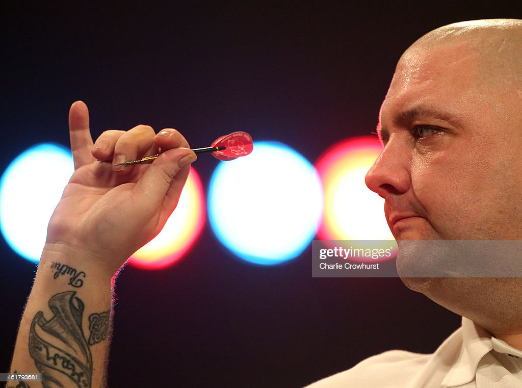 Robbie Green of England in action during his semi-final match against Stephen Bunting of England during the BDO Lakeside World Professional Darts Championships at Lakeside Complex on January 11, 2014 in Frimley, England.