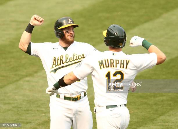 Robbie Grossman congratulates Sean Murphy of the Oakland Athletics after he hit a two-run home run against the Chicago White Sox in the fourth inning...