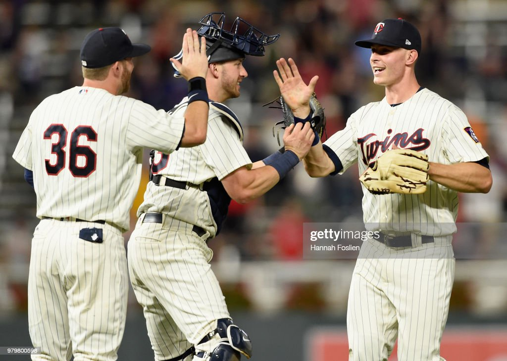 Robbie Grossman #36, Mitch Garver #23 and Max Kepler #26 of the Minnesota Twins celebrate defeating the Boston Red Sox after the game on June 20, 2018 at Target Field in Minneapolis, Minnesota. The Twins defeated the Red Sox 4-1.