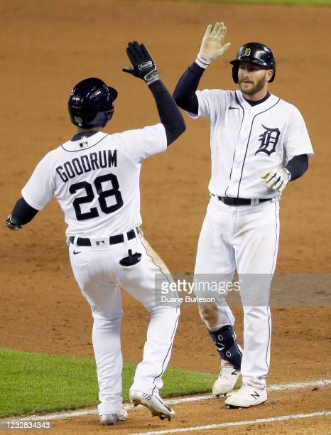 Robbie Grossman of the Detroit Tigers celebrates with Niko Goodrum after hitting a walk-off single that drove in Goodrum to defeat the Kansas City...