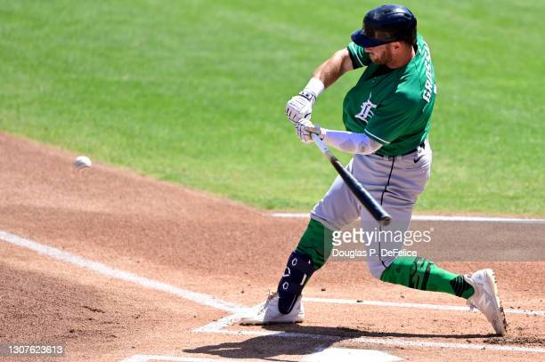 Robbie Grossman of the Detroit Tigers hits a single during the first inning against the Philadelphia Phillies during a spring training game at...