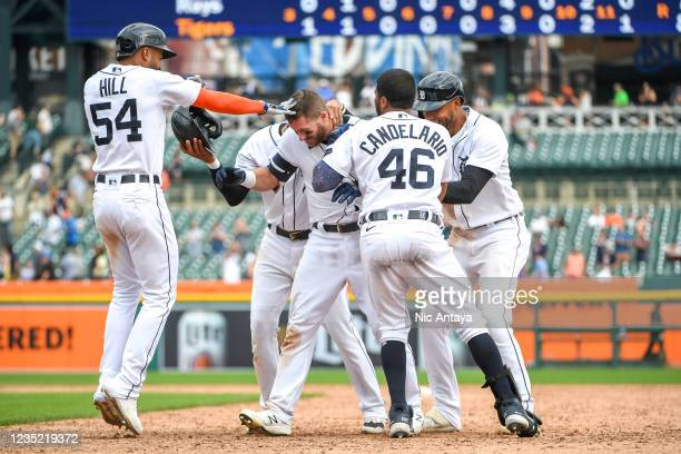 Robbie Grossman of the Detroit Tigers is congratulated by teammates Derek Hill, Harold Castro, Jeimer Candelario and Victor Reyes after drawing in a...