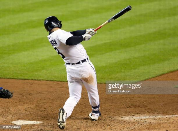 Robbie Grossman of the Detroit Tigers singles in the ninth inning to drive in Niko Goodrum and defeat the Kansas City Royals 8-7 at Comerica Park on...