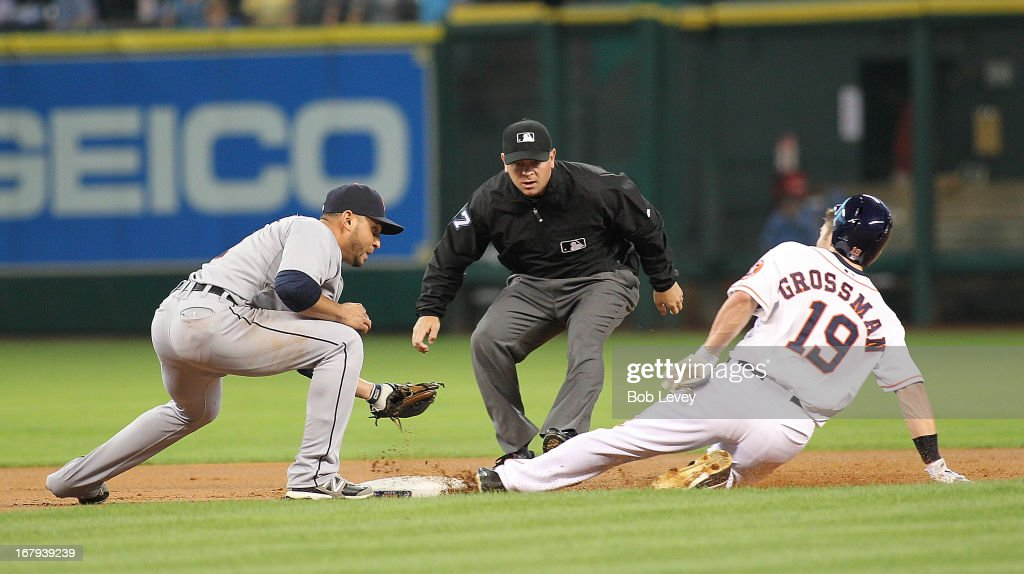 Robbie Grossman #19 of the Houston Astros slides safely into second base after hitting a double in the first inning as Omar Infante #4 of the Detroit Tigers is late with the tag at Minute Maid Park on May 2, 2013 in Houston, Texas.