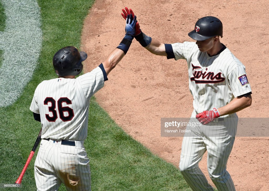 Robbie Grossman #36 of the Minnesota Twins congratulates teammate Max Kepler #26 on a solo home run against the Baltimore Orioles during the fifth inning of the game on July 7, 2018 at Target Field in Minneapolis, Minnesota. The Twins defeated the Orioles 5-4.