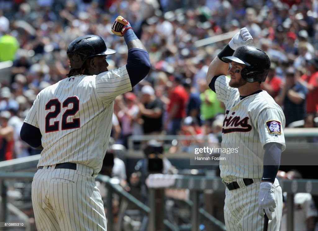 Robbie Grossman #36 of the Minnesota Twins congratulates teammate Miguel Sano #22 on a solo home run against the Baltimore Orioles during the third inning of the game on July 8, 2017 at Target Field in Minneapolis, Minnesota. The Orioles defeated the Twins 5-1.