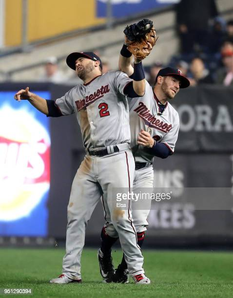 Robbie Grossman of the Minnesota Twins makes the catch for the out as he collides with teamamte Brian Dozier in the fourth inning against the New...