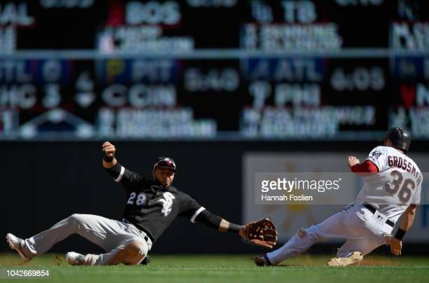 Robbie Grossman of the Minnesota Twins reaches second base on a wild pitch as the ball gets away from Leury Garcia of the Chicago White Sox during...