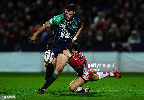 Robbie Henshaw of Connacht is tackled by James Hook of Gloucester during the European Rugby Challenge Cup match between Gloucester and Connacht at...