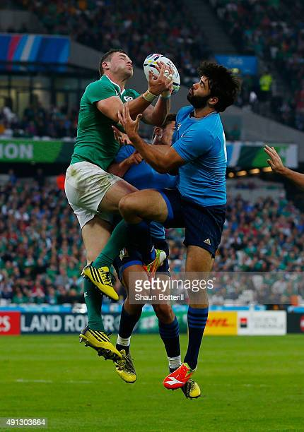 Robbie Henshaw of Ireland and Luke McLean of Italy compete for the high ball during the 2015 Rugby World Cup Pool D match between Ireland and Italy...