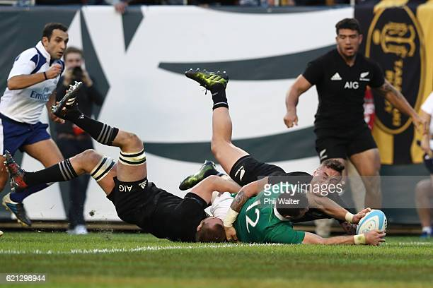 Robbie Henshaw of Ireland crashes over to score his team's fifth try during the international match between Ireland and New Zealand at Soldier Field...