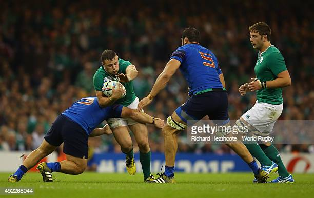 Robbie Henshaw of Ireland is stopped by Rabah Slimani of France during the 2015 Rugby World Cup Pool D match between France and Ireland at Millennium...