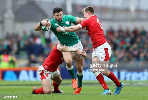 Robbie Henshaw of Ireland is tackled by Hadleigh Parkes of Wales and Nick Tompkins of Wales during the 2020 Guinness Six Nations match between...
