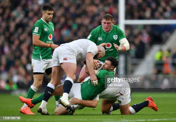 Robbie Henshaw of Ireland is tackled by Joe Marler and Jamie George of England during the 2020 Guinness Six Nations match between England and Ireland...