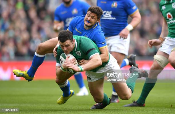 Robbie Henshaw of Ireland is tackled by Marcello Violi of Italy during the NatWest Six Nations match between Ireland and Italy at Aviva Stadium on...