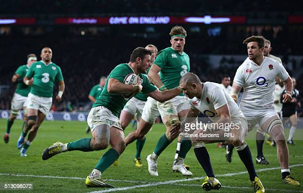 Robbie Henshaw of Ireland is tackled by Mike Brown of England during the RBS Six Nations match between England and Ireland at Twickenham Stadium on...
