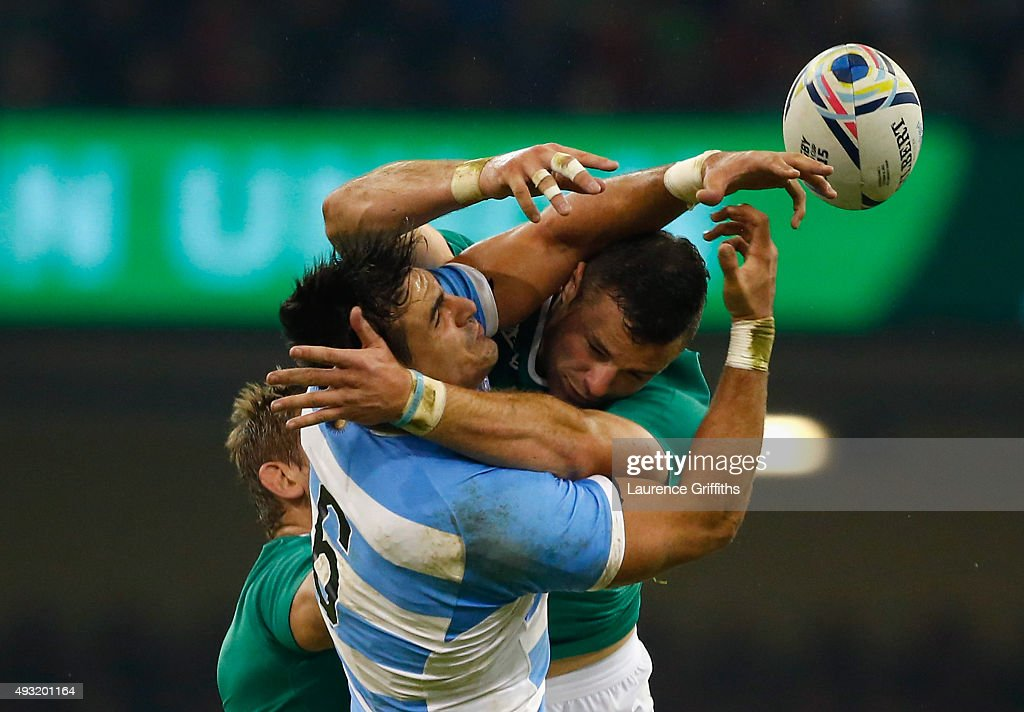 Robbie Henshaw of Ireland jumps for the ball with Pablo Matera of Argentina during the 2015 Rugby World Cup Quarter Final match between Ireland and Argentina at the Millennium Stadium on October 18, 2015 in Cardiff, United Kingdom.