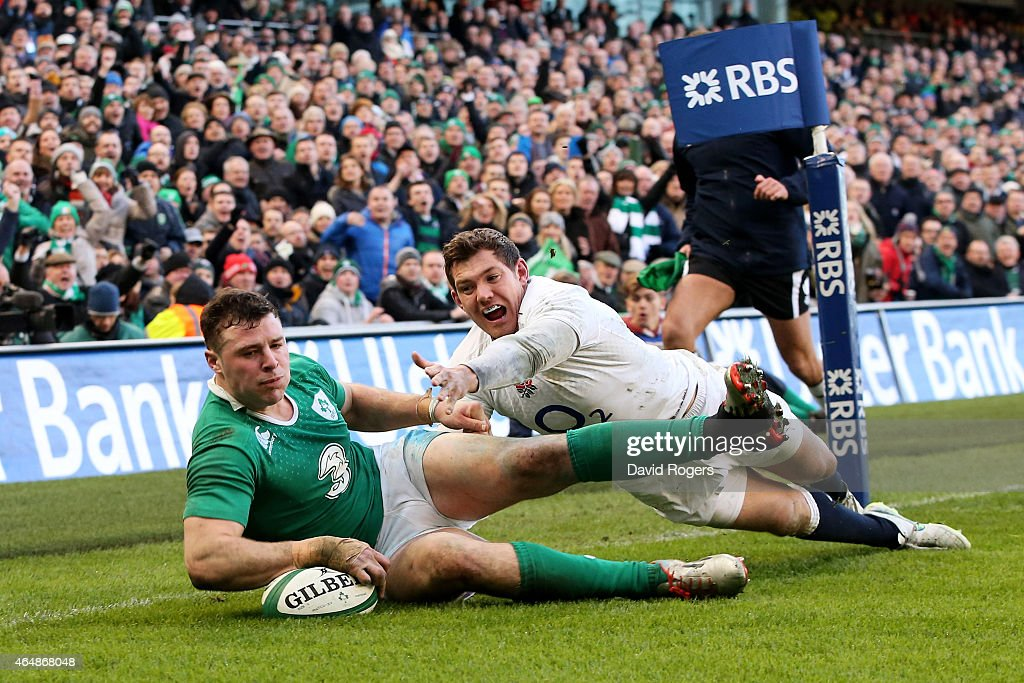 Robbie Henshaw of Ireland touches down the ball to score the opening try despite the efforts of Alex Goode of England during the RBS Six Nations match between Ireland and England at the Aviva Stadium on March 1, 2015 in Dublin, Ireland.