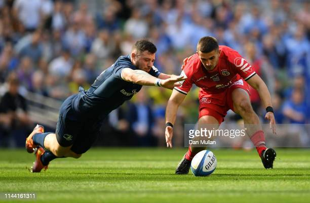 Robbie Henshaw of Leinster and Thomas Ramos of Toulouse battle for a loose ball during the Heineken Champions Cup Semi Final match between Leinster...