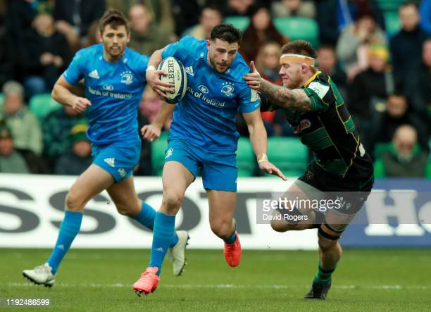Robbie Henshaw of Leinster goes past Teimana Harrison during the Heineken Champions Cup Round 3 match between Northampton Saints and Leinster Rugby...