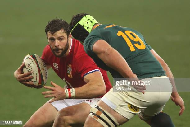 Robbie Henshaw of the British & Irish Lions attempts to get past Marco van Staden of South Africa during the 3rd Test between South Africa and the...